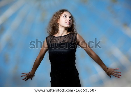Woman smiling happy with arms raised joyful Beautiful young girl Caucasian girl in her 20s. Freedom concept.  - stock photo