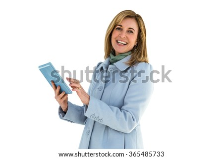 Woman smiling using her tablet - stock photo