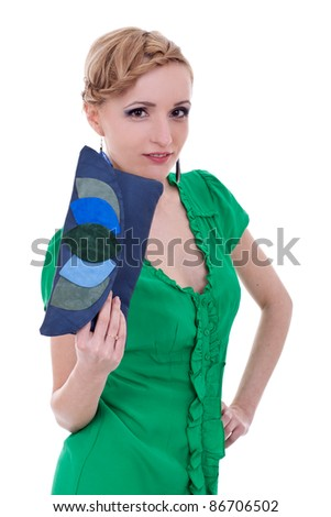 Woman smiling while holding purse against white background - stock photo