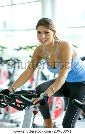 woman smiling while in a gym - stock photo