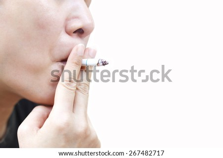 Woman smokes a cigarette in white background - stock photo