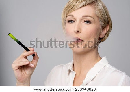 Woman smoking modern e-cigarette - stock photo