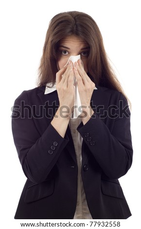 Woman sneezing nose having cold on white background - stock photo