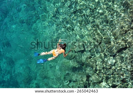 Woman snorkeling in the sea - stock photo