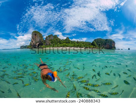 Woman snorkling in Poda Beach in Krabi Thailand - stock photo