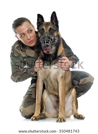 woman soldier and malinois in front of white background - stock photo