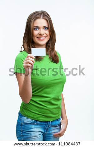 Woman sowing blank card. Isolated on white background smiling female portrait. Green color dressed. - stock photo