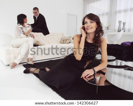woman speaks on a mobile phone and happy friends - stock photo