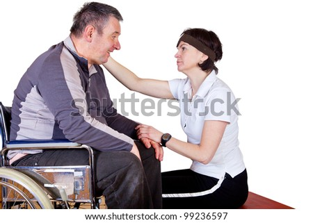 Woman speaks to man in a wheelchair comfort - stock photo