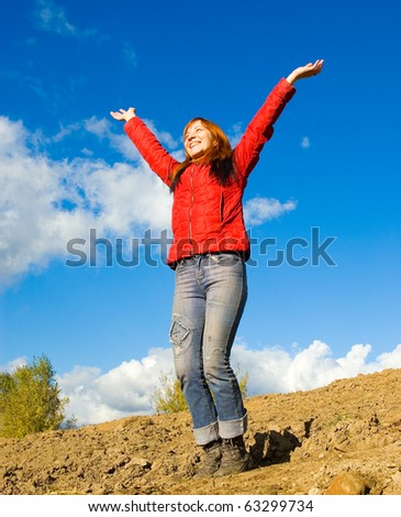 Woman spreading arms to sky - stock photo