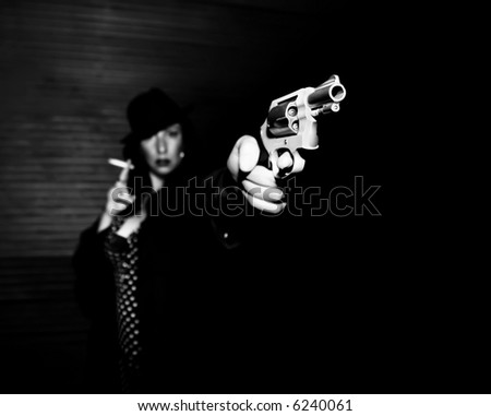 Woman spy aiming handgun smoking a cigarette. - stock photo