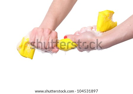 woman squeezing a wet cloth - stock photo