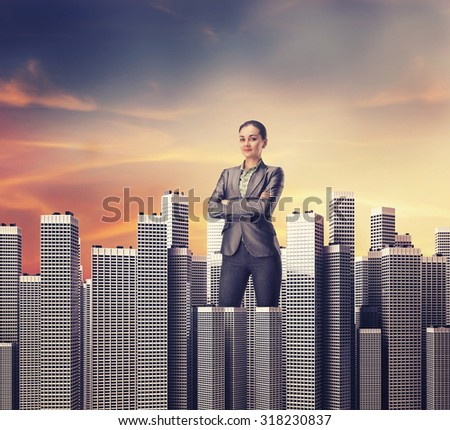 Woman standing among skyscrapers - stock photo
