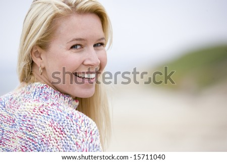 Woman standing at beach - stock photo