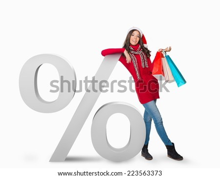 Woman standing next to a percent sign - stock photo