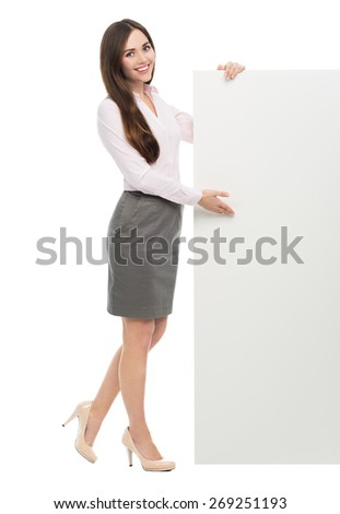 Woman standing next to big white poster  - stock photo