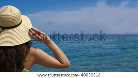 Woman standing on shoreline at the beautiful beach . Lots of copy space. - stock photo