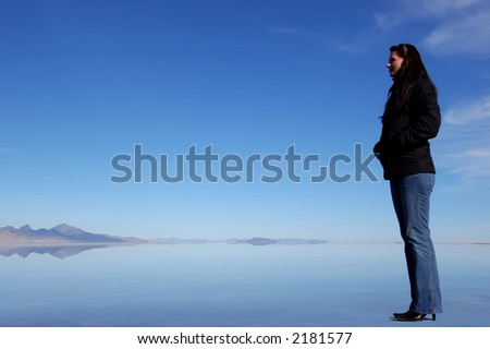 Woman standing on the water - stock photo