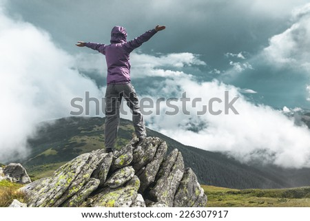 Woman standing on top of a mountain. Carpathians, Ukraine - stock photo