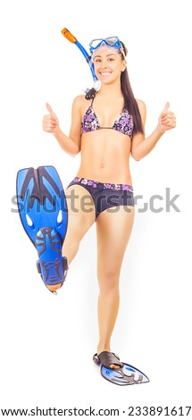 woman standing wearing snorkel holding snorkeling fins standing isolated on white - stock photo