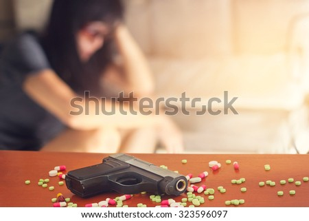 woman stress and depressed of her sickness, she decided to kill herself with a gun - stock photo