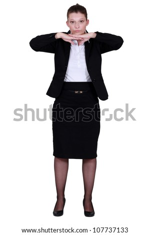 Woman stretching at the office - stock photo
