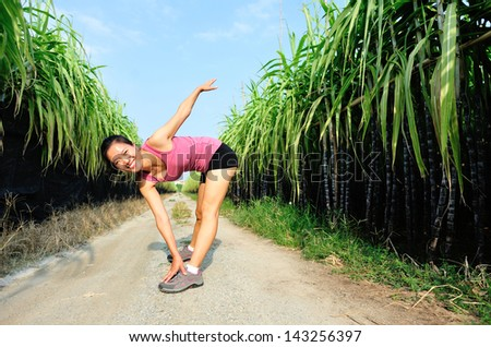 woman stretching at trail - stock photo