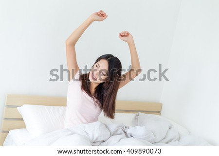Woman stretching in the morning and smiling - stock photo