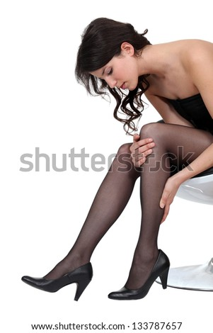 Woman stretching stockings - stock photo