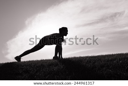 Woman stretching to run - stock photo