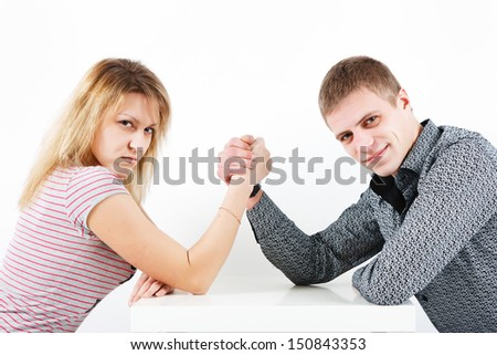Woman struggling with a man. family armwrestling - stock photo