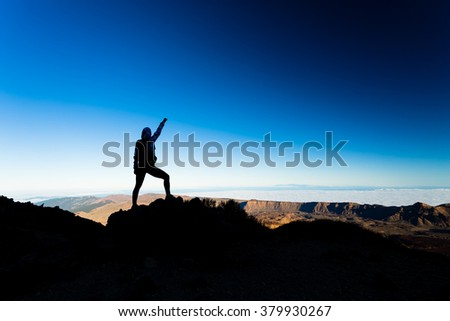 Woman successful hiking climbing silhouette in mountains, motivation and inspiration landscape on island and ocean. Hiker with arms up outstretched on mountain top looking at beautiful view. - stock photo