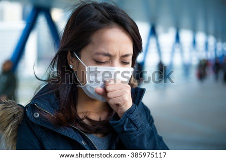 Woman suffer from cough with face mask protection - stock photo
