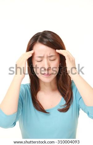 woman suffers from headache - stock photo