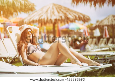 Woman sunbathing on a hot summer day in the tropics - stock photo