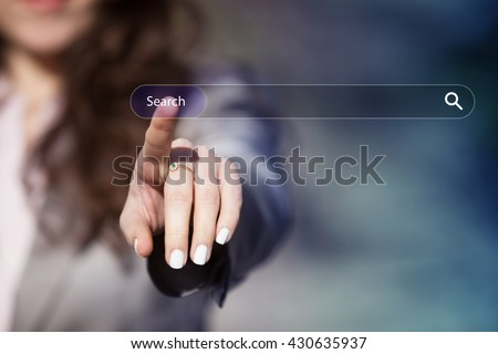 Woman surfing the internet by pressing search button on browser tab on virtual touch screen. - stock photo