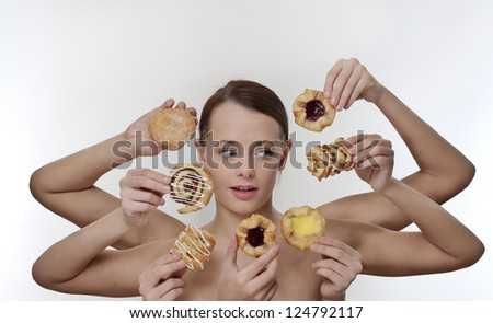 woman surrounded by many hands holding cream cakes with so much choice and temptation is she going to forget about her diet and indulge herself - stock photo