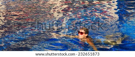 Woman swimming in the pool. Sport and recreation concept - stock photo