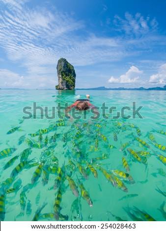 Woman swimming with snorkel, Andaman Sea, Thailand - stock photo