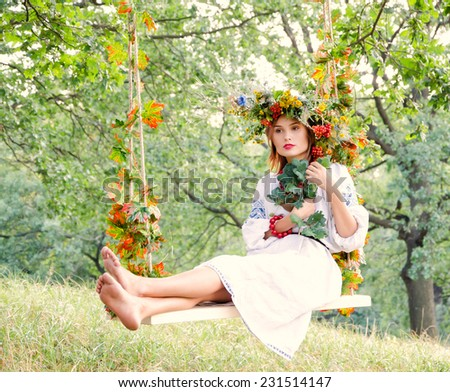 Woman swinging on the plank - stock photo