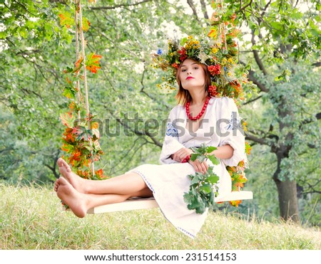 Woman swinging on the plank - stock photo