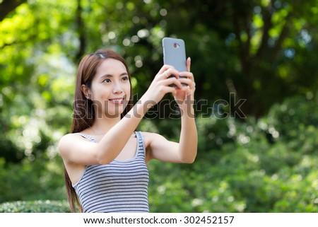 Woman take photo by mobile phone - stock photo