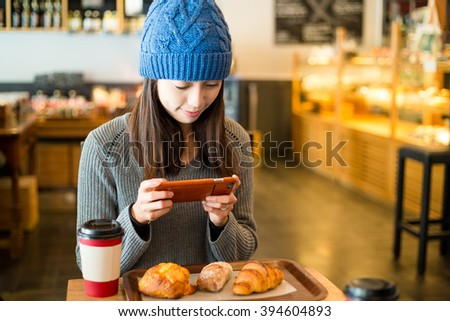Woman take photo on her breakfast - stock photo