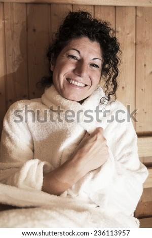 Woman takes a sauna. - stock photo