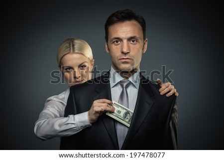 Woman takes money from businessman - stock photo