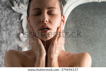 Woman taking a shower - stock photo