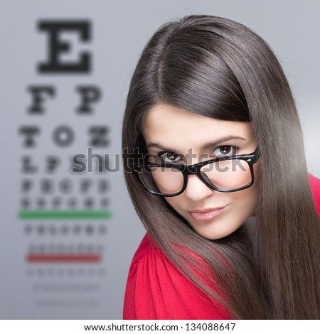 Woman taking an eye vision test - stock photo