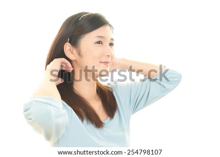 Woman taking care of her hair - stock photo