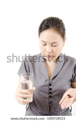 Woman taking her medicine isolated, selective focus on lady face. - stock photo