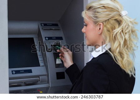 Woman taking money out - stock photo